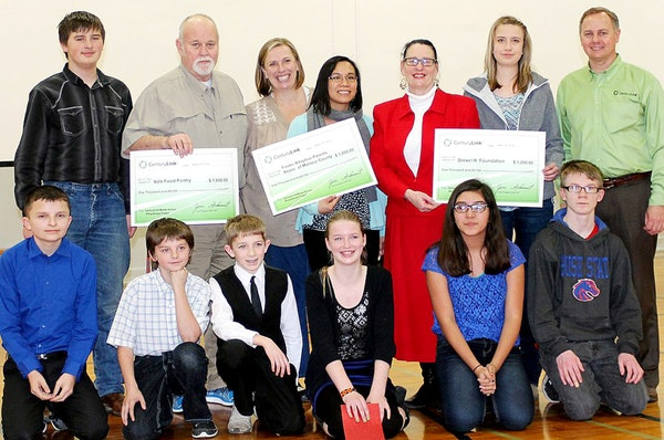 From left, students gather with grant recipients: (back) Blake Reed, Ric Bennett of the Vale Food Pantry, Janeille Bennett of FAPA, Sally Vergara-Clement of Department of Human Services, SandiJean Fuson of the Drexel Foundation, Kelsey Tolman of the Drexel Foundation, Jim Schmidt of CenturyLink; (front) Justin Buhrig, Trevor Malchow, Logan Cox, Alysa Dotson, Iliana Carrillo, Caleb Voechting. (Submitted photo)