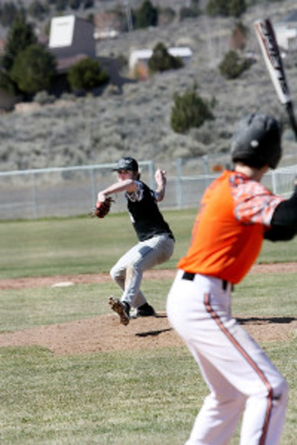 Cody Towers unleashes a pitch at a Willamina batter during the Burns tournament. (Photo submitted by Pattie Hamilton)