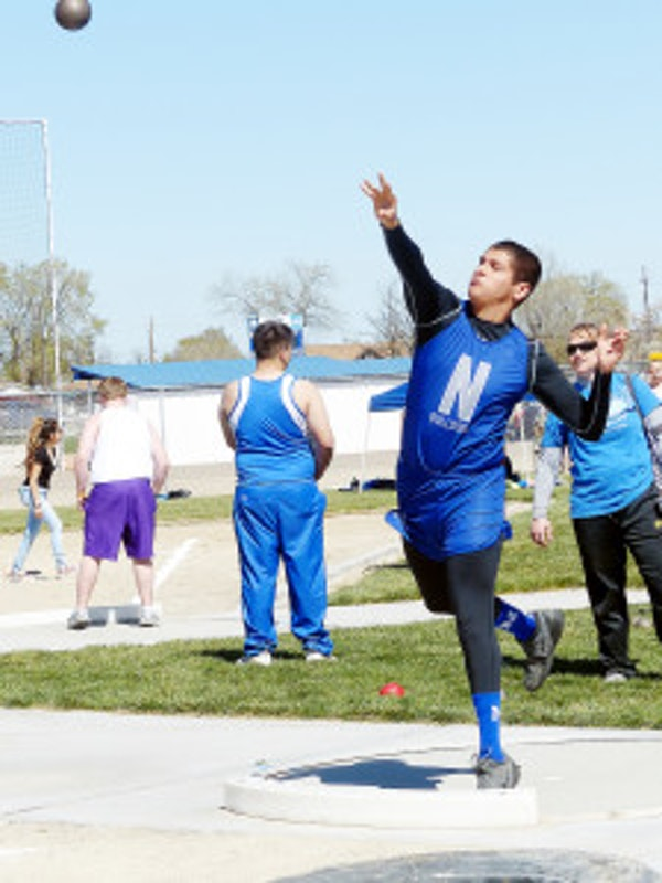 Nyssa's Ramiro Duenas heaves the shot for fifth place and the best local athlete performance in the field event. (Enterprise photos/Scotta Callister)