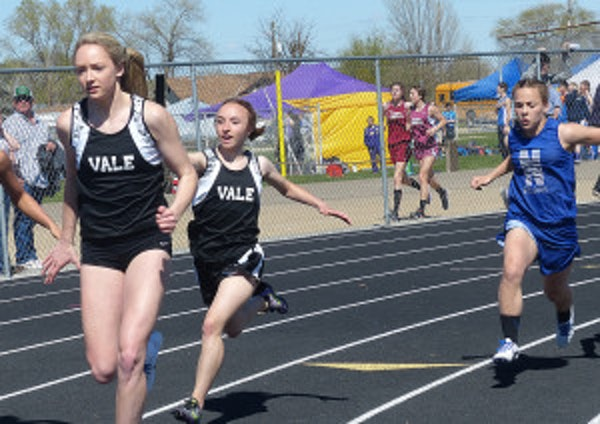 Vale runners pass the baton in the relay events. (Enterprise photos/Scotta Callister)