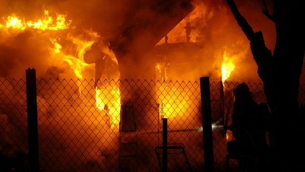 Local firefighters try to quell a blaze early Friday morning that destroyed a home southeast of Willowcreek. PHOTO: John Braese