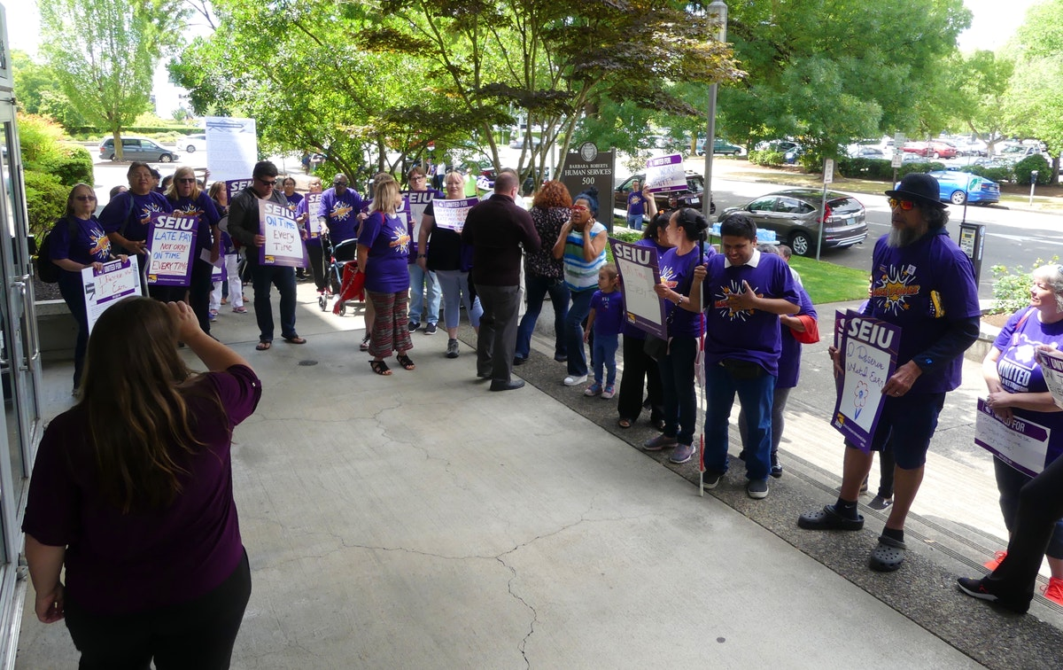 Homecare workers hold protest outside of DHS over late pay